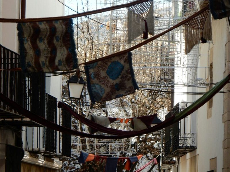 Flags, banners, railings, wrought iron balconies.