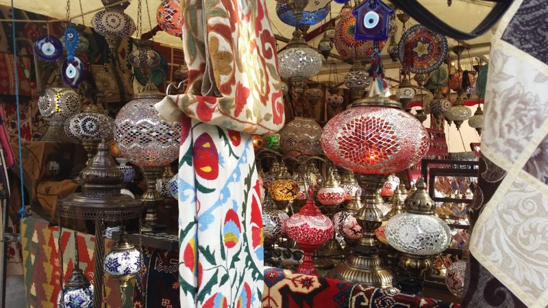 Red, blue, yellow, green, orange lamps and tapestries.