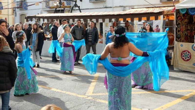Blue scanty dresses and scarves. Dancing ladies.