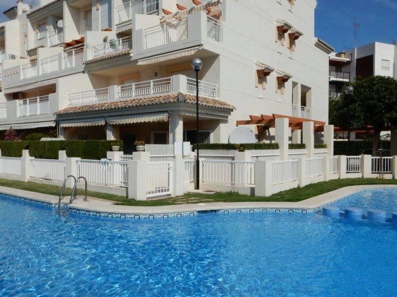 Las Dunas apartment sunshine and blue swimming pool Javea Spain